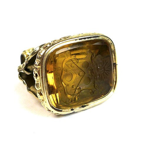 214 - A Victorian gold plated fob seal, the rococo scroll mount set with an intaglio carved smoked quartz,...