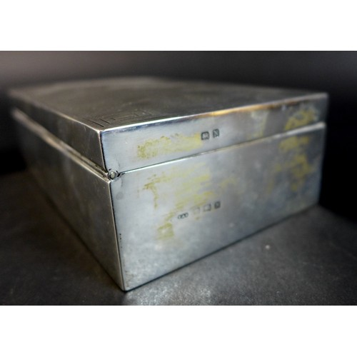 75 - An Art Deco silver cigarette box, with engine turned decoration and Greek Key pattern to the corners...
