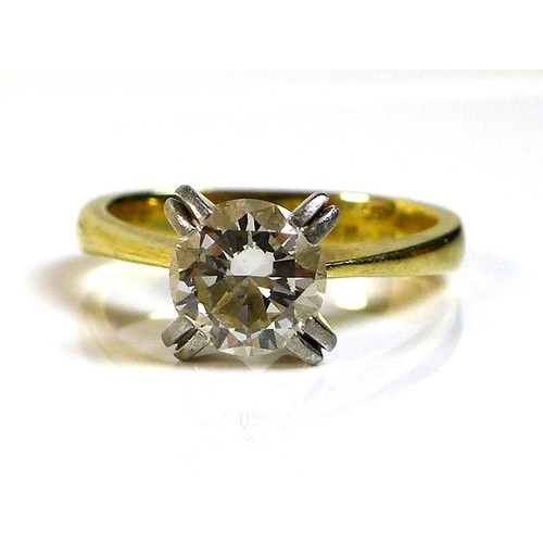 405 - A diamond and 18ct gold and white gold solitaire ring, the diamond of approximately 1ct, approximate...