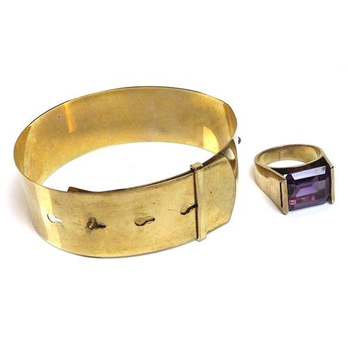 352 - A 9ct gold buckle bangle bracelet, 14.8g, together with a modernist design 9ct gold and emerald cut ...
