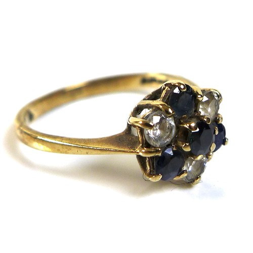336 - A 9ct gold, diamond and sapphire flowerhead ring, central round cut sapphire set about with three fu...