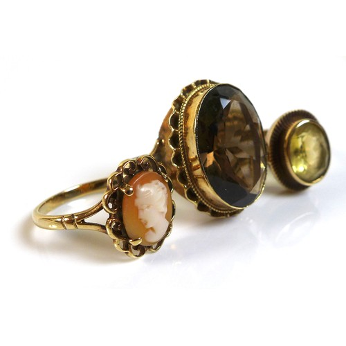 357 - A group of three 9ct gold rings, comprising a citrine ring, size L, a cameo ring, size N, and a smok...