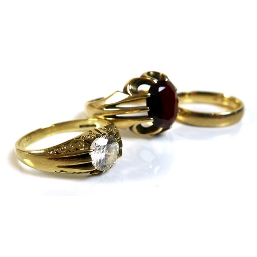 333 - A group of three 9ct gold rings, comprising a gentlemen's ring set with an oval red stone, possibly ...