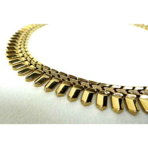 410 - A gold Cleopatra style necklace, circa 1980, testing as 18ct, 41cm long, 48.3g.