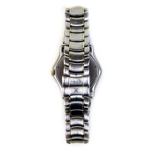 208 - An Ebel 1911 bi-colour ladies wristwatch, with Roman numeral dial, date aperture, an 18ct gold bezel...