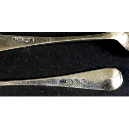 51 - Seven pieces of George III Hanoverian pattern  silver flatware, comprising a table spoon, 22cm long,...
