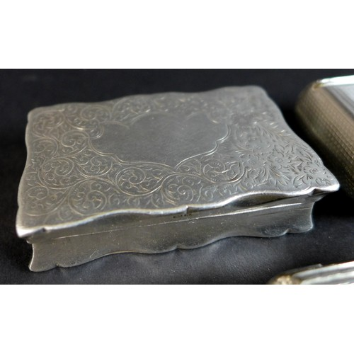 91 - An early 20th century silver box of scallopped rectangular form with engraved scrolling acanthus to ...