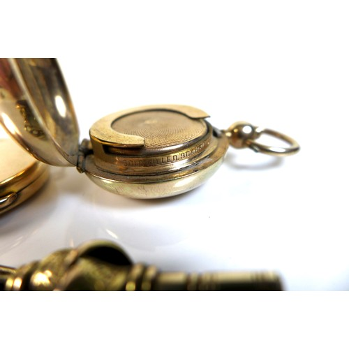 359 - A 15ct gold circular locket, marked 15ct, 11.6g, together with a rolled gold sovereign holder, an un...