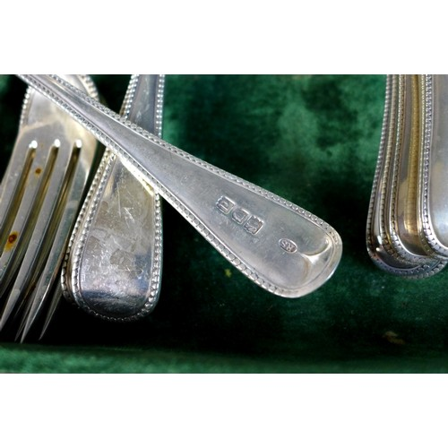 174 - A canteen of Victorian and later silver flatware, comprising a collection of old English beaded patt...