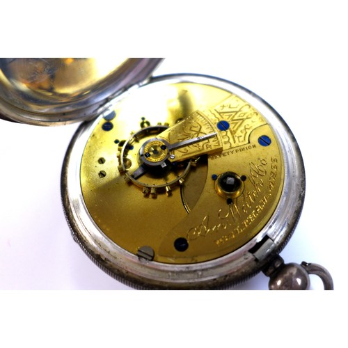 236 - A silver cased Waltham pocket watch, together with two Albert chains, one with key and pendant medal...