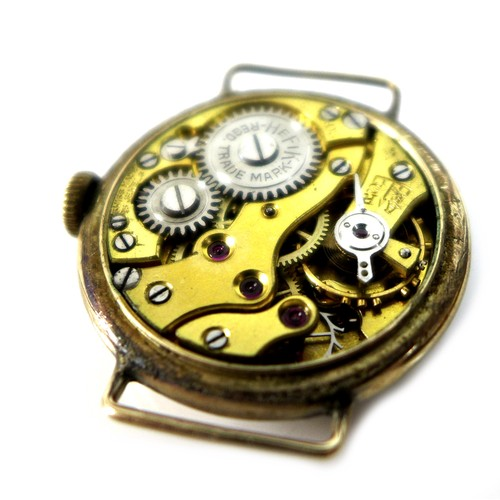 202 - A 9ct gold lady's watch head, with Arabic dial, 10g gross, together with a vintage Service Court 'Of...