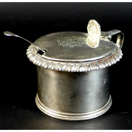 79 - A William IV silver mustard pot, monogrammed lid with shell form thumb piece, gadrooned rim, blue gl...