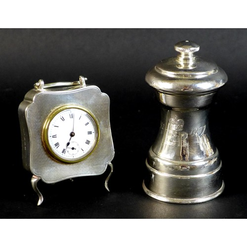 48 - A George V silver cased travel clock of quatrefoil form, with machine turned decoration, rubbed make...