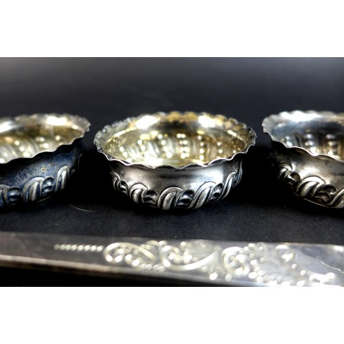 96 - A group of Victorian and later decorative silver comprising four bonbon dishes, of swirl gadrooned d...
