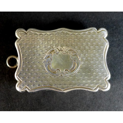 40 - A Victorian silver vinaigrette, of shaped rectangular form, with wave engine turned decoration to th...