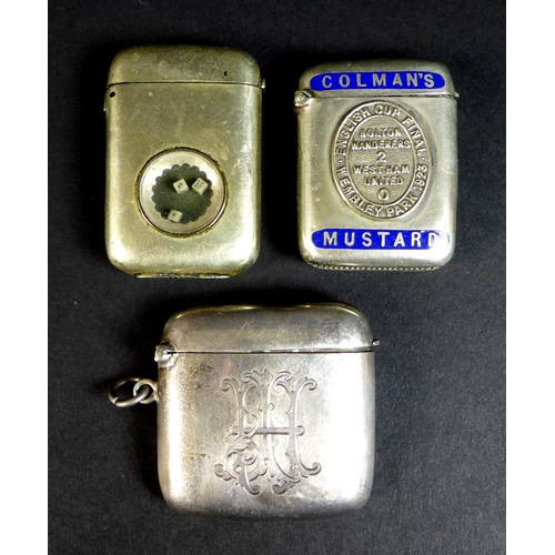 41 - A group of three vesta cases, comprising a Victorian silver example of curved rectangular form, John...
