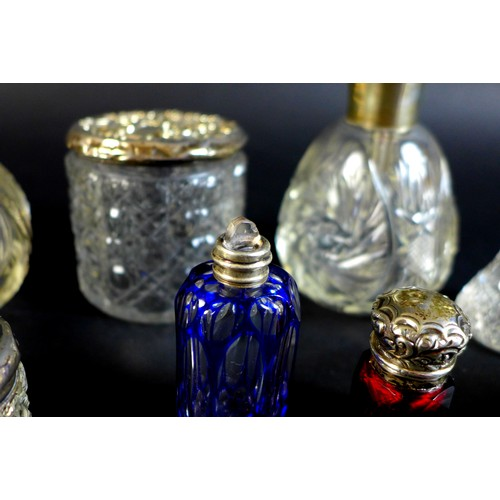 84 - A Victorian silver scent bottle, of cylindrical form, the whole decorated with rococo scrolls and fl...