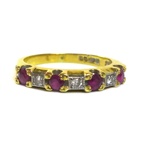 346 - An 18ct gold, ruby and diamond seven stone ring, each of the four rubies of approximately 2.8mm, int...