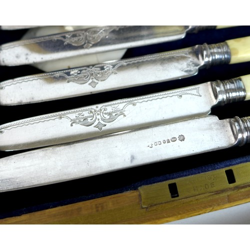 9 - A group of silver plated wares, comprising a Victorian set of fish servers, with carved ivory handle...