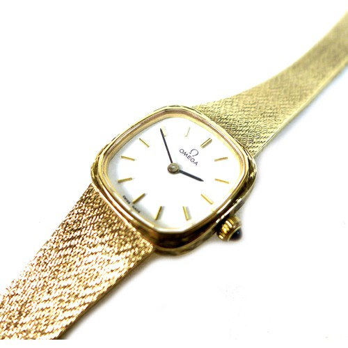 222 - An Omega 9ct gold cased lady's wristwatch, model 7115598, circa 1990, the square white dial with rou...