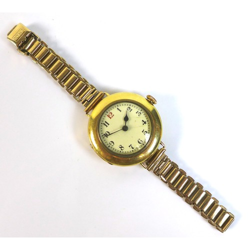 221 - An Art Deco Baume & Company 18ct gold lady's wire lug wristwatch, circular cream dial with black Rom...
