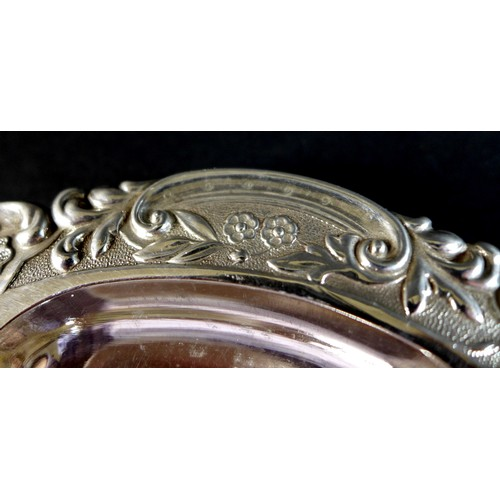 38 - A Victorian silver butter dish, with five lobed bowl, shaped outline with repousse Rococo style deco...