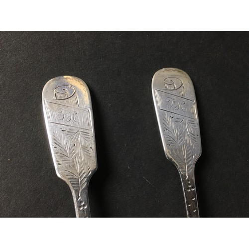 16 - A pair of late Victorian silver pickle forks, fiddle pattern with engraved decoration and terminals ...
