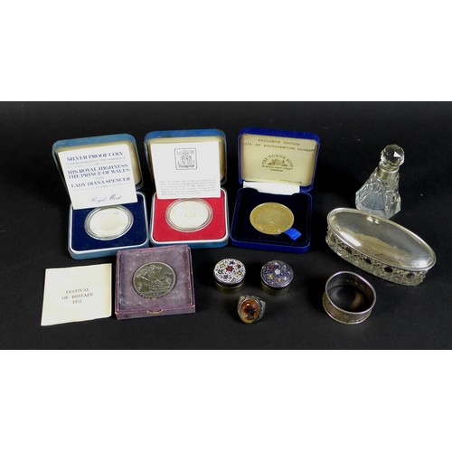 55 - A collection of silver items and coins, including two dressing table items, a scent bottle with whit...
