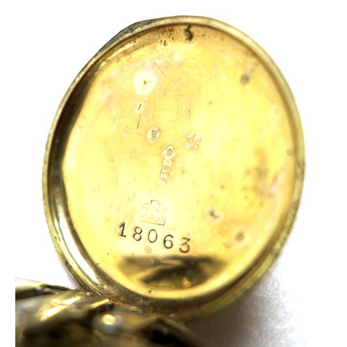 335 - A group of 9ct gold jewellery, comprising a lady's vintage 9ct gold cased wristwatch with guilloche ...