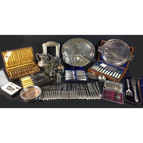 13 - A collection of silver plated wares, including a Mappin & Webb twin handled wine holder decorated wi...