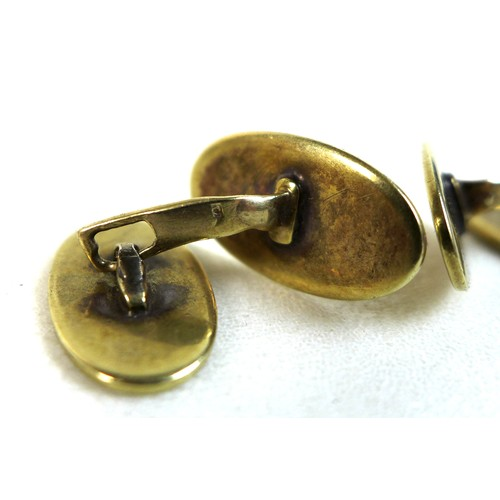345A - A pair of 19th century Continental 14ct gold cufflinks, oval form with recessed line border, angled ...