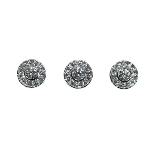 414 - A pair of gentleman's 18ct white gold and diamond cufflinks, together with three matching shirt stud...