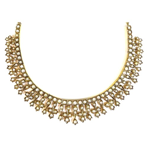 409 - An 18ct gold and seed pearl fringed collerette necklace, likely 19th century, with quatrefoil and ha...