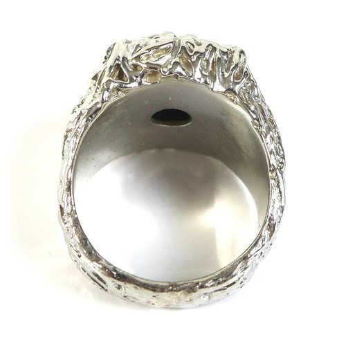 412 - An American 14K white gold over yellow gold diamond cluster ring, of unusual modernist design, circa...