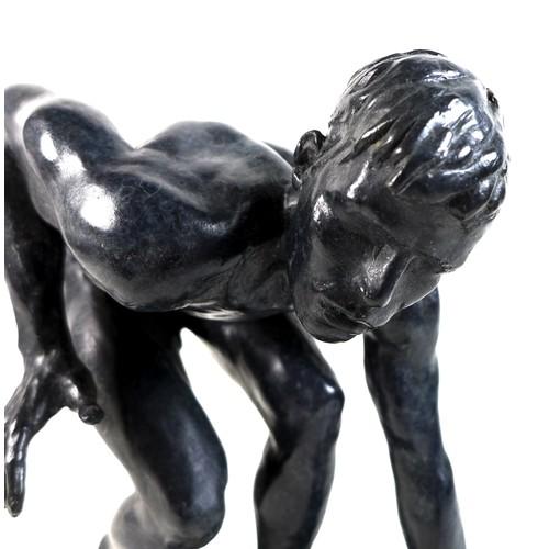 85 - Ian Rank-Broadley FRBS (British, b. 1952): 'Crouching Youth', a bronze figural sculpture, with dark ...