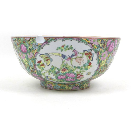 54 - A modern Chinese Canton porcelain bowl, 31 by 14cm high, containing a collection of ornaments, mostl...