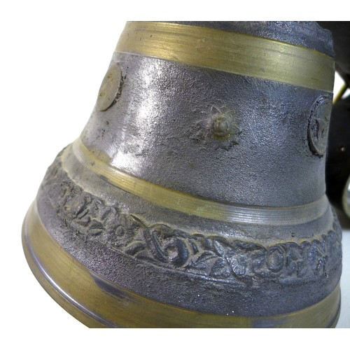 57 - A French cast metal cow bell, 'Puy Mary', 22.5 by 19cm high, with wide leather strap....