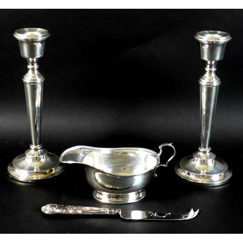 22 - A pair of silver candlesticks, each 21cm high with weighted bases, Francis Howard, Birmingham 1974, ...