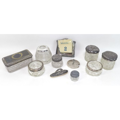 12 - A group of silver topped dressing table items, including glass cosmetics pots, tallest 6cm high, rec...