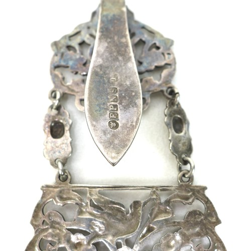 1 - A Edwardian silver plated chatelaine, the belt buckle featuring Green Man decoration, fitted with si...