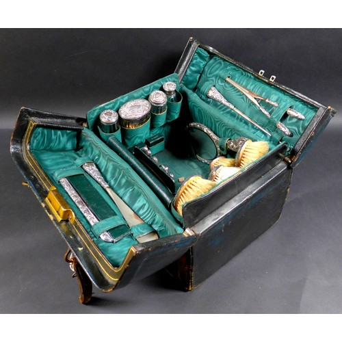 45 - A Victorian/Edwardian Vanity case with silver dressing table wares, featuring three  Victorian silve...