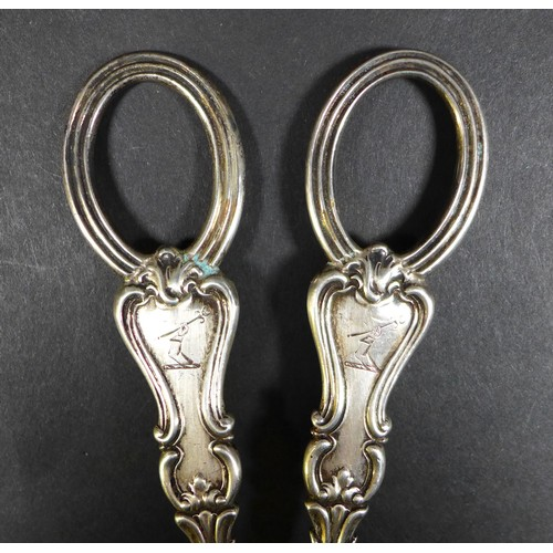15 - A pair of Victorian silver grape shears, inscribed with 'Fernside to Belmont' and two armorial crest...