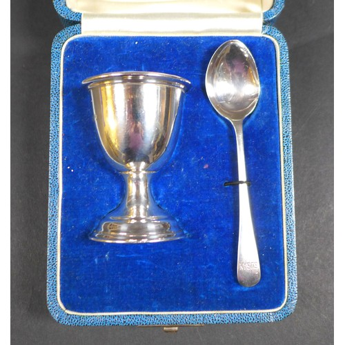 29 - Three George V and later cased silver Christening sets, comprising an egg and cup set, both inscribe...