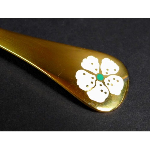 32 - A Georg Jensen gilt Sterling silver 1971 year spoon, with enamel cherry blossom to its finial, Desig...