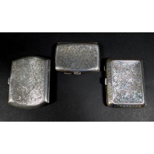40 - Three Edwardian and later silver cigarette cases, all with parcel gilt interiors, comprising one wit...