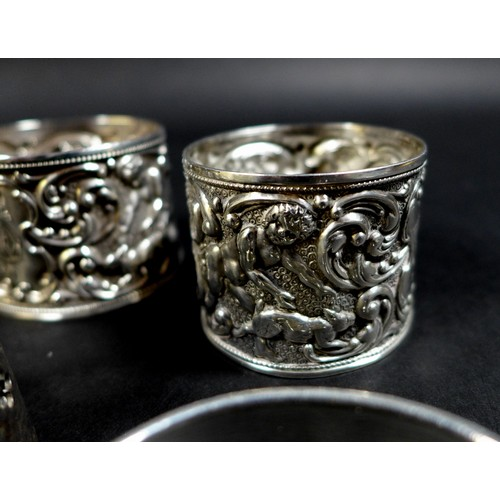 35 - A collection of Edwardian and later silver napkin rings, including three Edwardian rings, two with p...