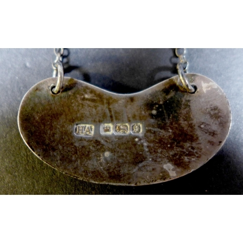 10 - A George V silver decanter label, of kidney form with line border, engraved 'Brandy', Atkin Brothers...