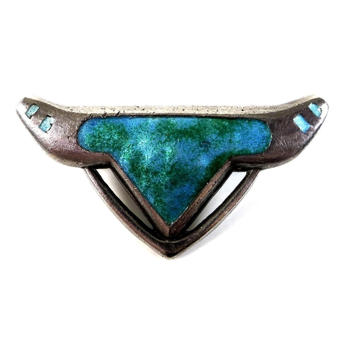 102 - An Art Nouveau Charles Horner silver brooch, of organic pierced form, decorated with green and turqu...