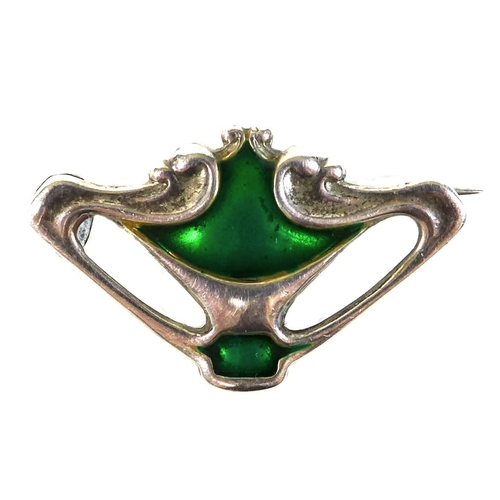 105 - An Art Nouveau Charles Horner silver brooch, of organic pierced form, decorated with green enamel, p...