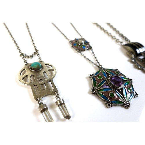 107 - A group of four white metal Art Nouveau style and Art Deco levalier necklaces, comprising one of cir...